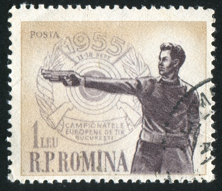 vintage riffle: ROMANIA - CIRCA 1955: stamp printed by Romania, shows Sharpshooter, circa 1955