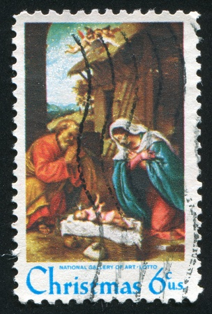 UNITED STATES - CIRCA 1970: stamp printed by Umited States, shows Nativity by Lorenzo Lotto, circa 1970 photo