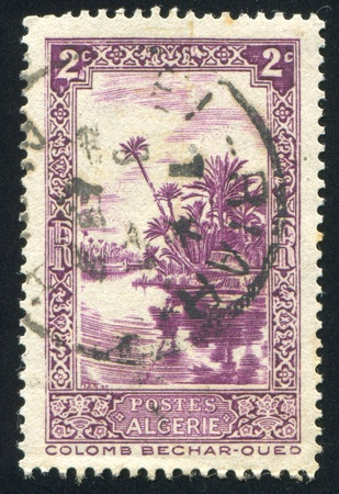vintage riffle: ALGERIA CIRCA 1936: stamp printed by Algeria, shows Oued River at Colomb-Bechar, circa 1936 Stock Photo