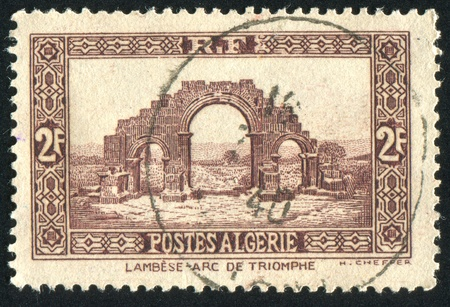 ALGERIA CIRCA 1940: stamp printed by Algeria, shows Arch of Triumph, Lambese, circa 1940 photo