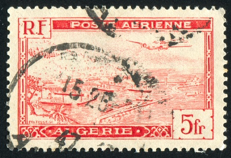ALGERIA CIRCA 1946: stamp printed by Algeria, shows Plane over Algiers Harbor, circa 1946 Stock Photo - 10717977