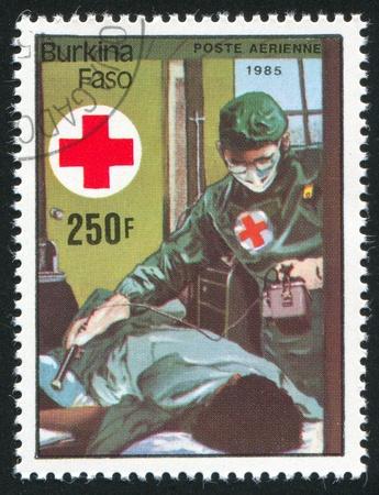 BURKINA FASO - CIRCA 1985: stamp printed by Burkina Faso, shows doctor, circa 1985. Stock Photo - 10717745