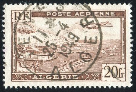 ALGERIA CIRCA 1946: stamp printed by Algeria, shows Plane over Algiers Harbor, circa 1946 Stock Photo - 10755907