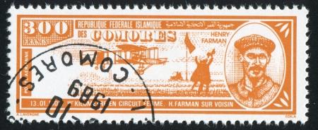 henri: COMORO ISLANDS - CIRCA 1988: stamp printed by Comoro islands, shows airplane and Henri Farman, circa 1988 Editorial