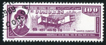 alberto: Comores Islas - alrededor de 1988: Sello impreso por las islas Comoro, muestra avi�n y Alberto Santos Dumont, alrededor de 1988