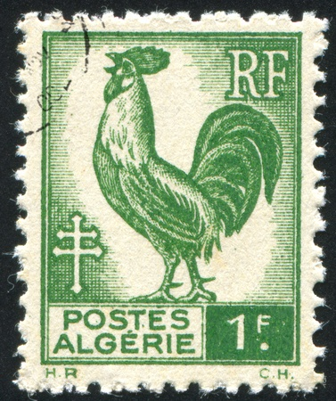 ALGERIA CIRCA 1945: stamp printed by Algeria, shows Gallic Cock, circa 1945 Stock Photo - 10792914