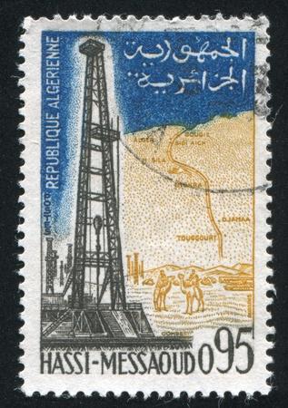 ALGERIA CIRCA 1962: stamp printed by Algeria, shows Oil field Hassi Messaoud,  circa 1962 photo