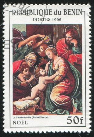 BENIN CIRCA 1996: stamp printed by Benin, shows The Holy Family, by Raphael, circa 1996 photo