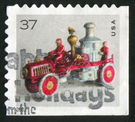 pumper: UNITED STATES - CIRCA 2002: stamp printed by United States of America, shows toy fire pumper, circa 2002