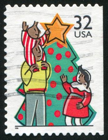 UNITED STATES - CIRCA 1996: stamp printed by United States of America, shows decoratig tree, circa 1996 Stock Photo - 10792611