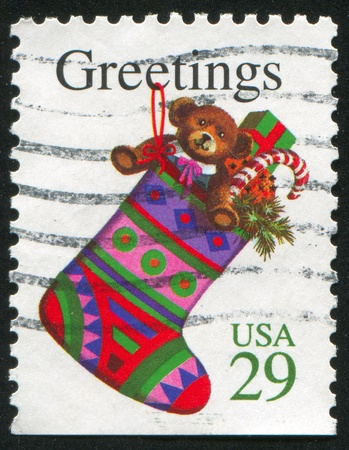 stoking: UNITED STATES - CIRCA 1994: stamp printed by United States of America, shows stoking with presents, circa 1994 Stock Photo