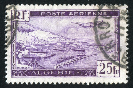 ALGERIA CIRCA 1946: stamp printed by Algeria, shows Plane over Algiers Harbor, circa 1946 Stock Photo - 10821764