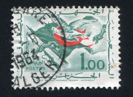 ALGERIA CIRCA 1963: stamp printed by Algeria, shows Flag, Rifle, Olive Branch, circa 1963 photo
