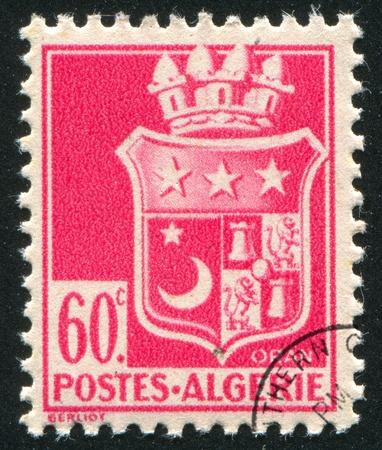 ALGERIA - CIRCA 1946: stamp printed by Algeria, shows arms, circa 1946. photo