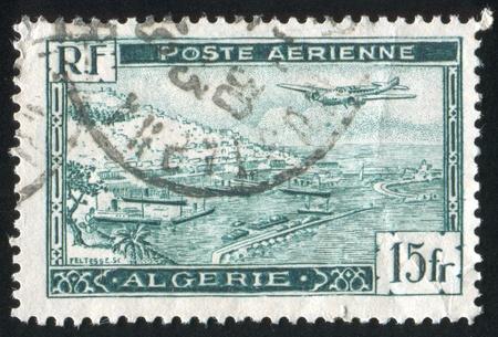 ALGERIA CIRCA 1946: stamp printed by Algeria, shows Plane over Algiers Harbor, circa 1946 Stock Photo - 10821821