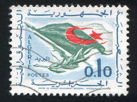 ALGERIA CIRCA 1963: stamp printed by Algeria, shows Flag, Rifle, Olive Branch, circa 1963 photo