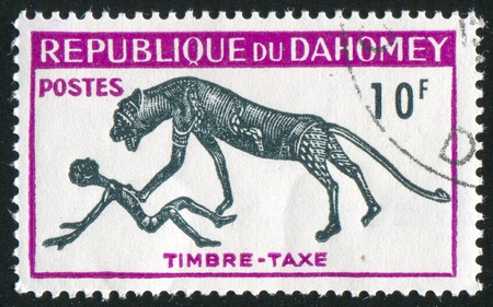 DAHOMEY - CIRCA 1966: stamp printed by Dahomey, shows  leopard has attacked the person, circa 1966. Stock Photo - 10821796