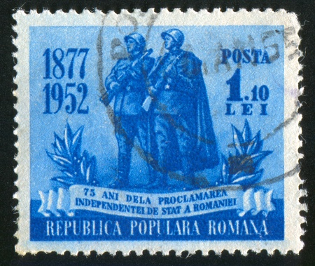 jackboots: ROMANIA - CIRCA 1952: stamp printed by Romania, shows Romanian and Russian soldiers, circa 1952 Stock Photo