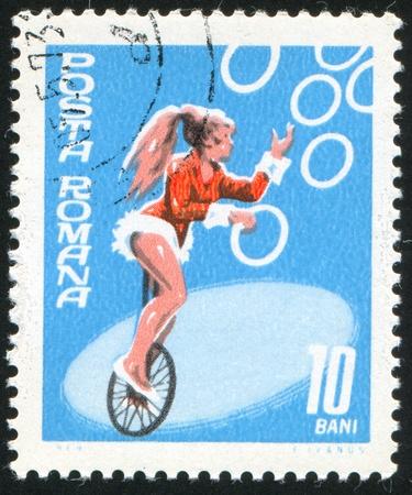 circus performers: ROMANIA - CIRCA 1969: stamp printed by Romania, shows Circus Performers, Juggler on Unicycle, circa 1969