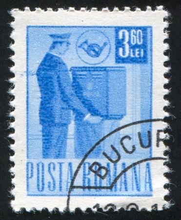 ROMANIA - CIRCA 1971: stamp printed by Romania, shows Mail collector, circa 1971 Stock Photo - 10839312