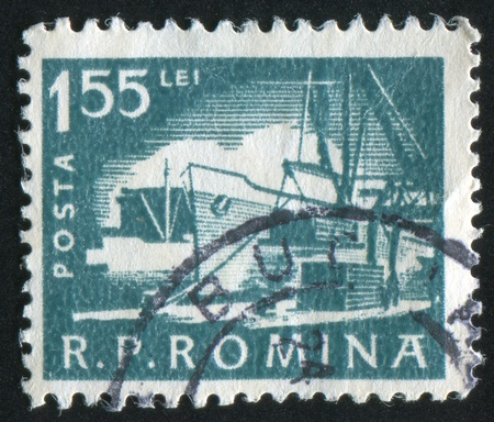 ROMANIA - CIRCA 1960: stamp printed by Romania, shows Loading ship, circa 1960 Stok Fotoğraf