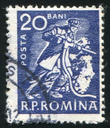 jackboots: ROMANIA - CIRCA 1960: stamp printed by Romania, shows Miner with drill, circa 1960