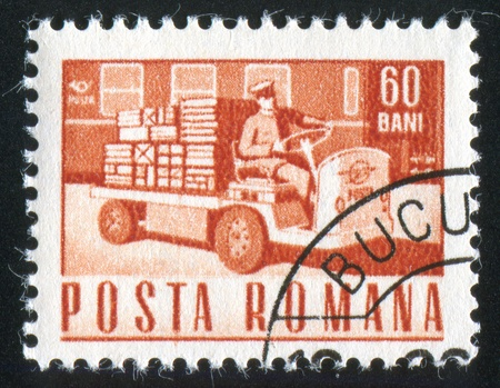 ROMANIA - CIRCA 1967: stamp printed by Romania, shows Small loading truck, circa 1967 Stock Photo - 10839331