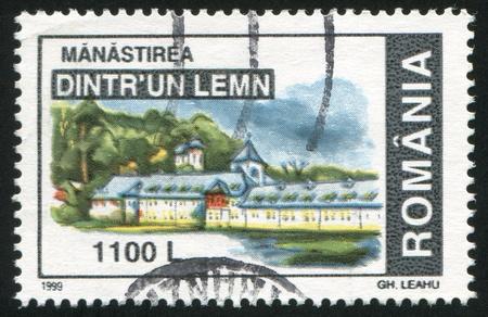 window seal: ROMANIA - CIRCA 1999: stamp printed by Romania, shows Monastery Dintrun Lemn, circa 1999