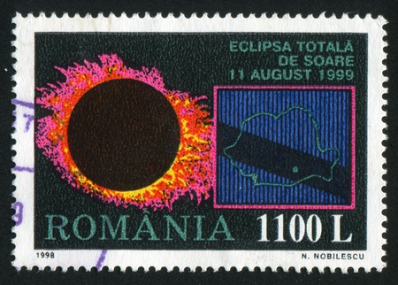 ROMANIA - CIRCA 1998: stamp printed by Romania, shows Total Eclipse of the Sun, 1999, circa 1998 Stock Photo - 10838784