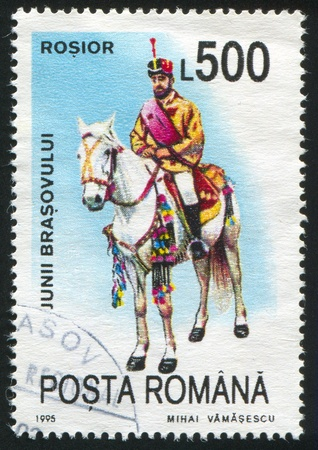 ROMANIA - CIRCA 1995: stamp printed by Romania, shows Riders representing municipal districts of Brasov, Rosior, circa 1995 Stock Photo - 10838636