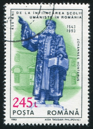 ROMANIA - CIRCA 1993: stamp printed by Romania, show statue of Johannes Honterus, founder of first Humanitarian Schoolm, circa 1993 Stock Photo - 10838590