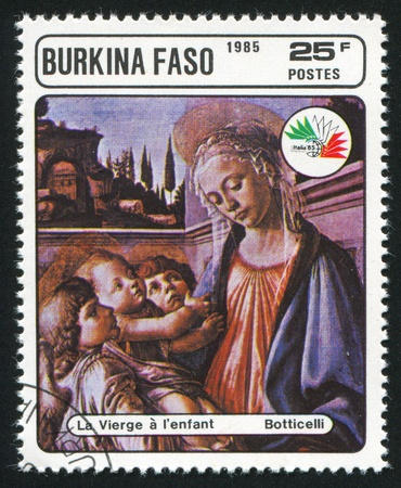 BURKINA FASO CIRCA 1985: stamp printed by Burkina Faso, shows Virgin and Child, Botticelli, circa 1985 photo