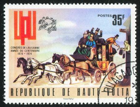 BURKINA FASO CIRCA 1974: stamp printed by Burkina Faso, shows Mail Coach, circa 1974 photo