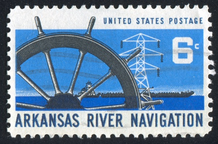UNITED STATES - CIRCA 1968: stamp printed by United States of America, shows ship wheel, power transmission tower and barge, circa 1968 photo