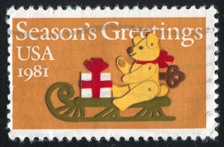 UNITED STATES -CIRCA 1981: stamp printed by United States of America, shows  felt bear on the sled, circa 1981 photo