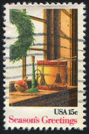 UNITED STATES - CIRCA 1980: stamp printed by United States of America, shows wreth and toys on windowsill, circa 1980 photo