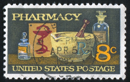 mortar and pestle medicine: UNITED STATES - CIRCA 1972: stamp printed by United States of America, shows mortar and pestle, bowl of  Hygeia, circa 1972