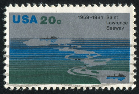 seaway: UNITED STATES - CIRCA 1984: stamp printed by United States of America, shows Aerial view of Seaway, freighters, circa 1984 Stock Photo