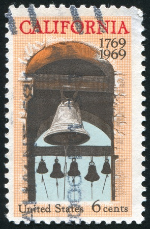 peal: UNITED STATES - CIRCA 1969: stamp printed by United States of America, shows Carmel mission belfry, circa 1969