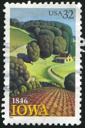 iowa agriculture: UNITED STATES - CIRCA 1996: stamp printed by United States of America, shows house in the fields, forest, circa 1996