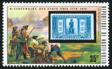 vintage riffle: BURKINA FASO - CIRCA 1975: stamp printed by Burkina Faso, shows Minutemen, circa 1975