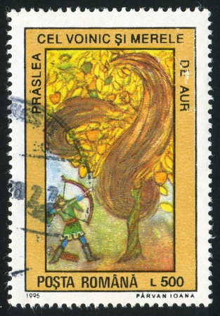 jackboots: ROMANIA - CIRCA 1996: stamp printed by Romania, shows Romanian Fairy Tales, Archer aiming at apple tree, circa 1996