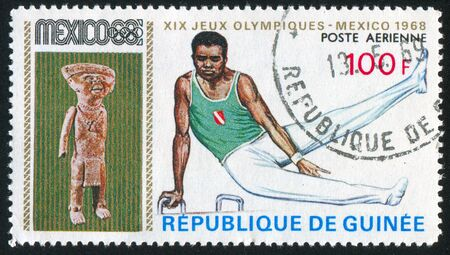 GUINEA - CIRCA 1969:   stamp printed by Guinea,  shows gymnast, circa 1969. Stock Photo - 10979516