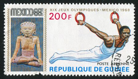 GUINEA - CIRCA 1969:   stamp printed by Guinea,  shows gymnast, circa 1969. Stock Photo - 10979518