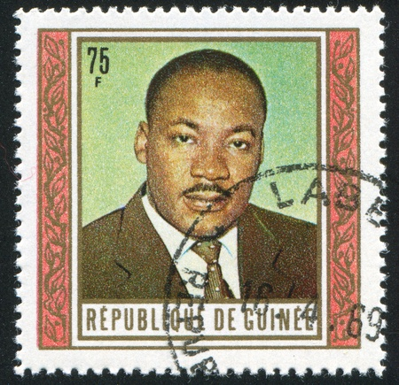 martin luther king: GUINEA - CIRCA 1968:   stamp printed by Guinea,  shows Martin Luther King, circa 1968.