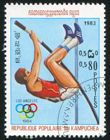 knees bent: CAMBODIA CIRCA 1983: stamp printed by Cambodia, shows Pole vault, circa 1983