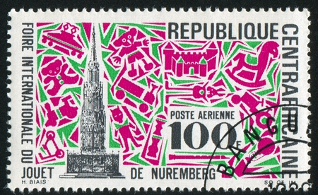 CENTRAL AFRICAN REPUBLIC 1969: stamp printed by Central African Republic, shows Market Cross, Nuremberg, and Toys, circa 1969 photo