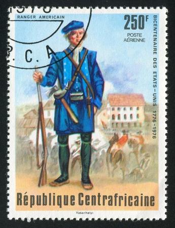 vintage riffle: CENTRAL AFRICAN REPUBLIC - CIRCA 1976: stamp printed by Central African Republic, shows American ranger, circa 1976