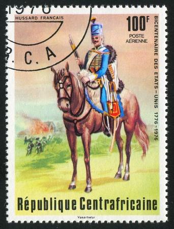 vintage riffle: CENTRAL AFRICAN REPUBLIC - CIRCA 1976: stamp printed by Central African Republic, shows French Hussar, circa 1976 Stock Photo