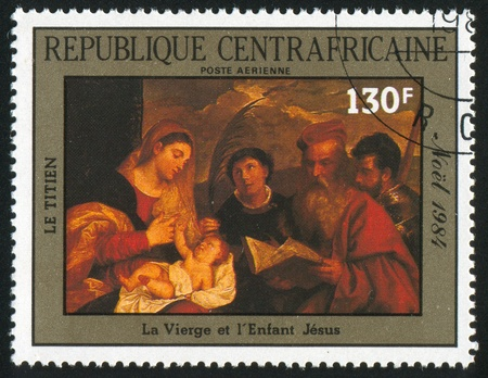 infant jesus: CENTRAL AFRICAN REPUBLIC - CIRCA 1985: stamp printed by Central African Republic, shows Painting by Titian, Virgin and Infant Jesus, circa 1985
